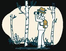 Ein Jäger beobachtet Wild im Wald